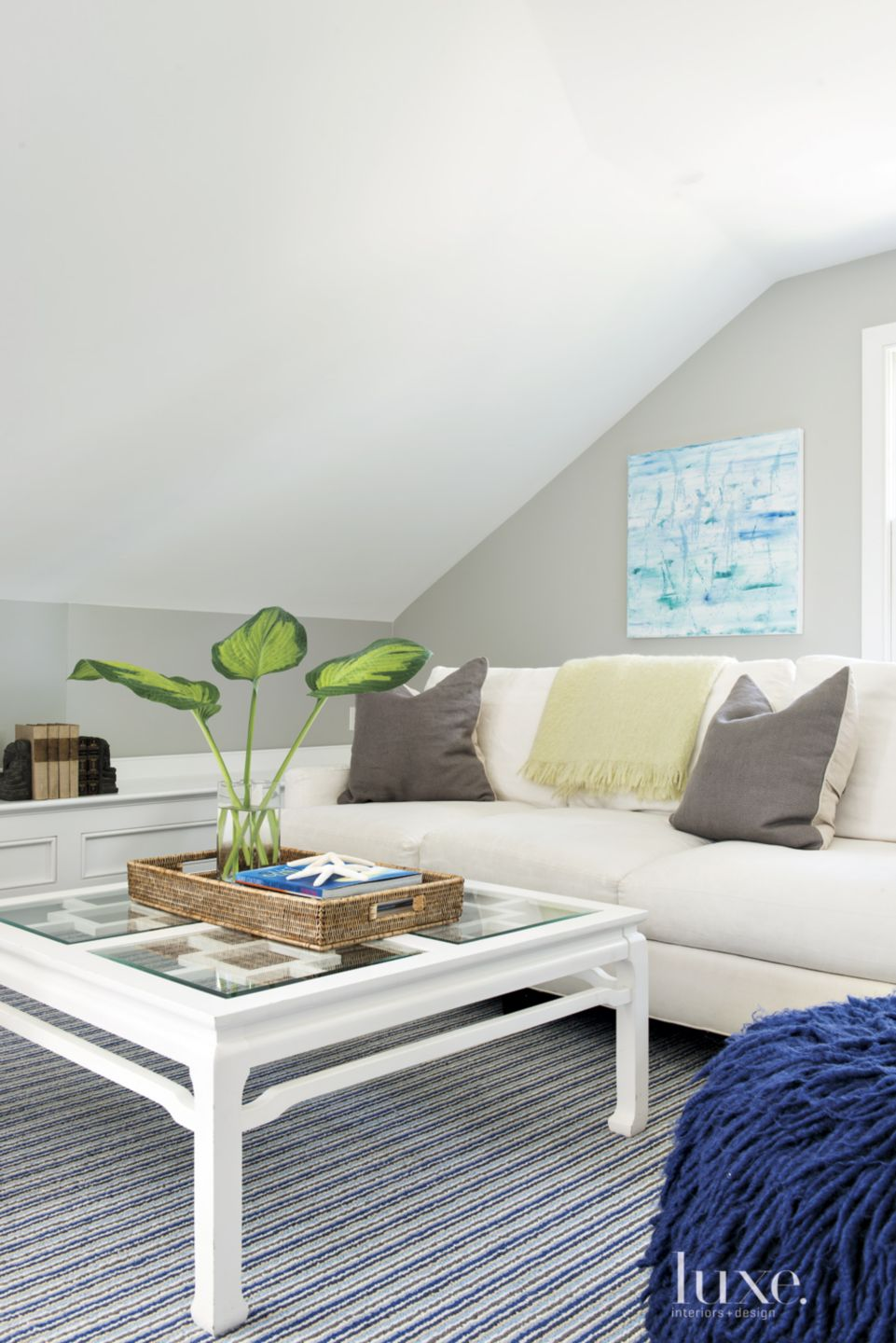 Contemporary Neutral Attic with Striped Blue Rug