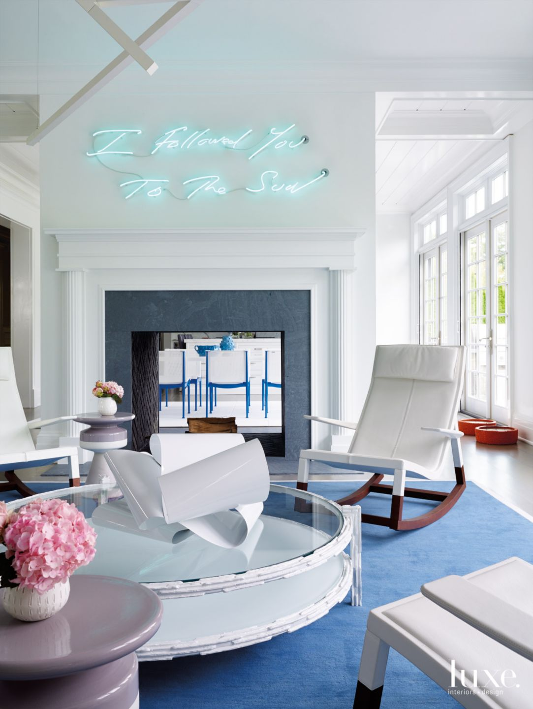 Contemporary White Lounge Area with Neon Art