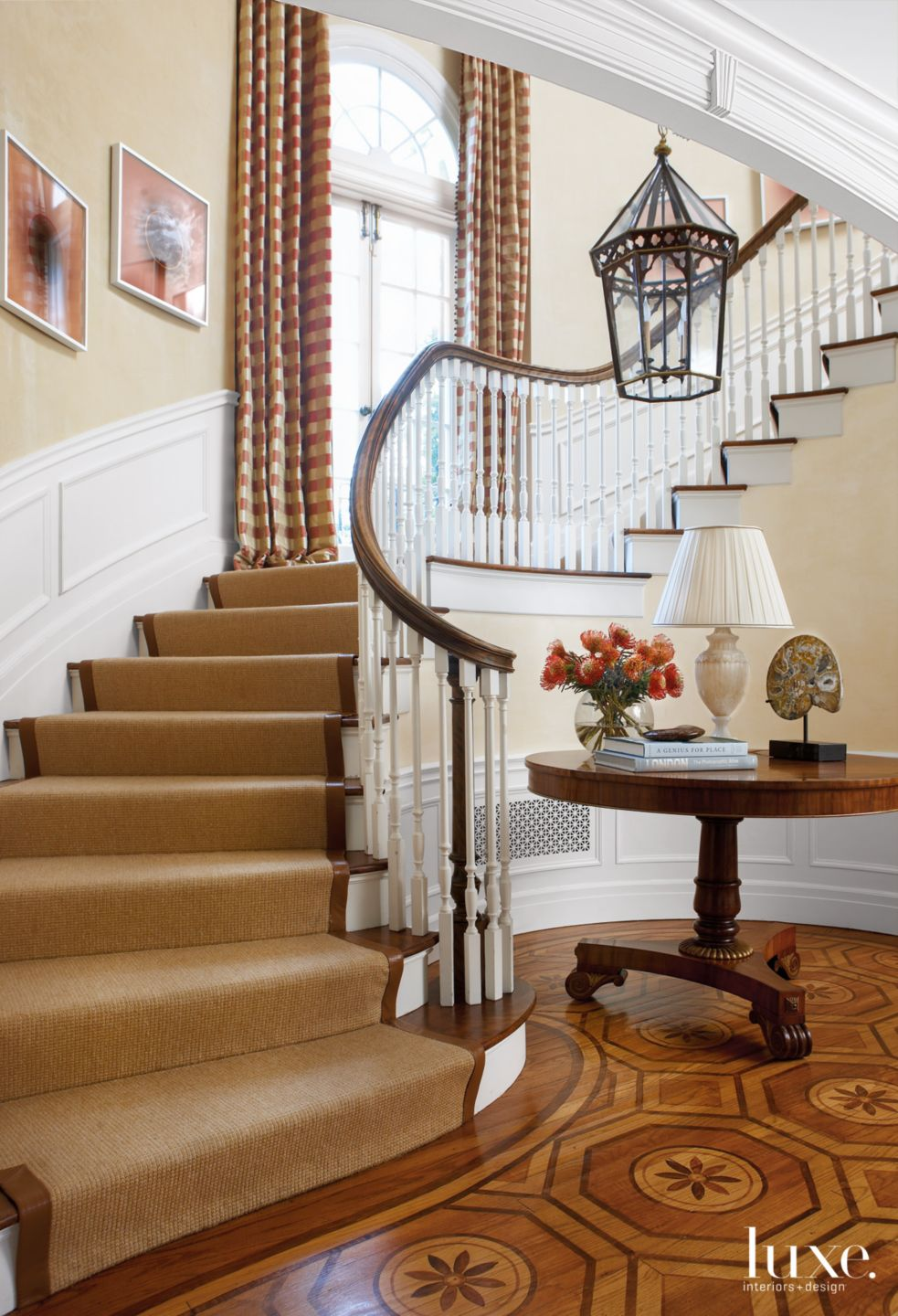 Traditional Cream Foyer with Curved Staircase