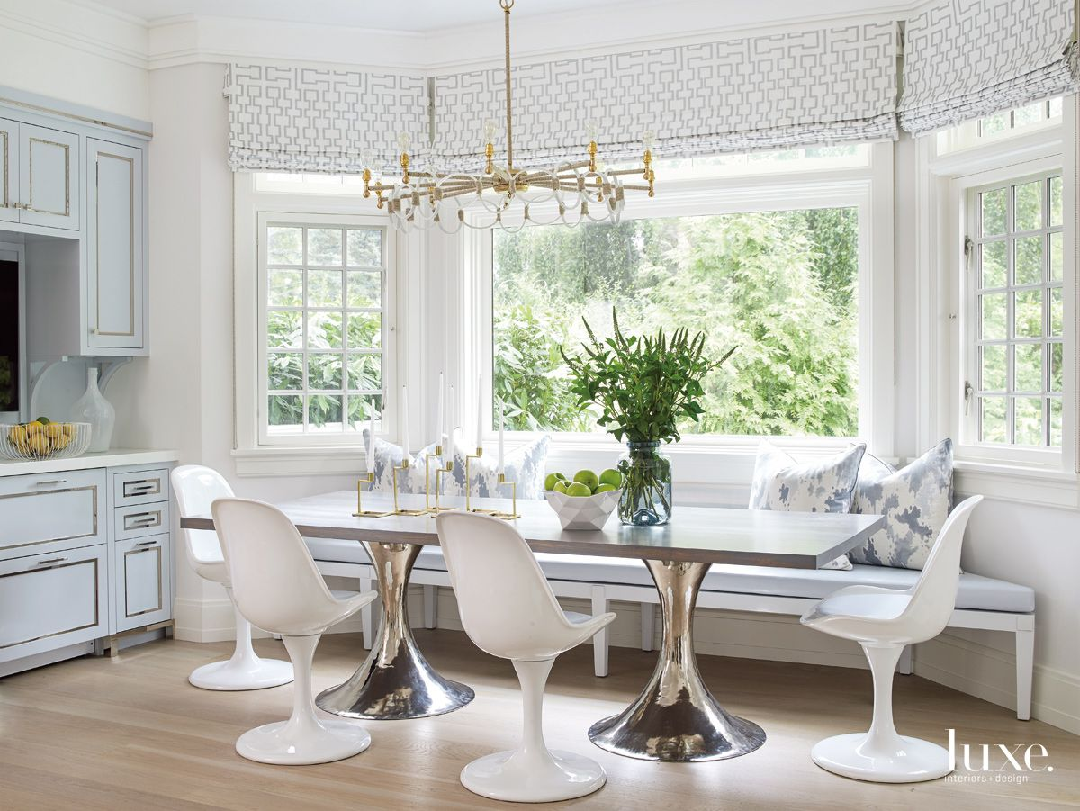Modern White Breakfast Area with Tulip Chairs