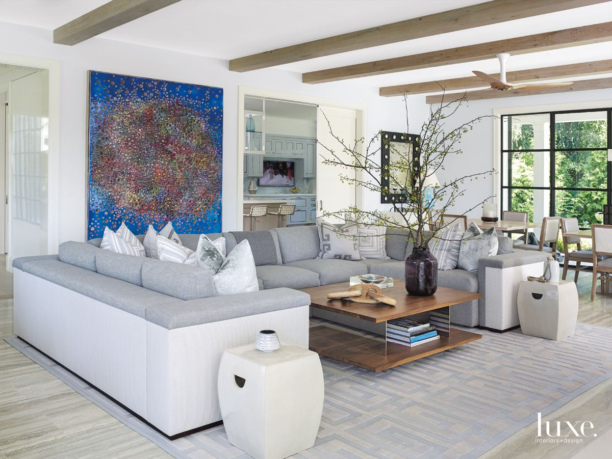 Modern White Living-Dining Area with Wood Painting