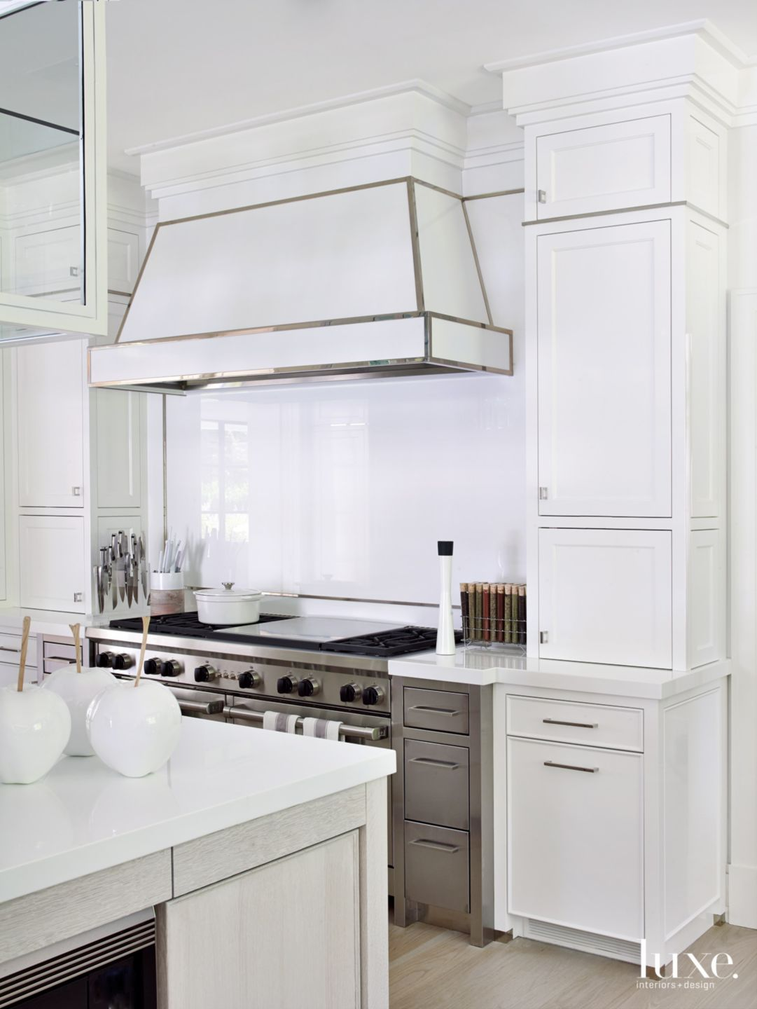 Modern White Kitchen with Nickel-Trimmed Cabinetry