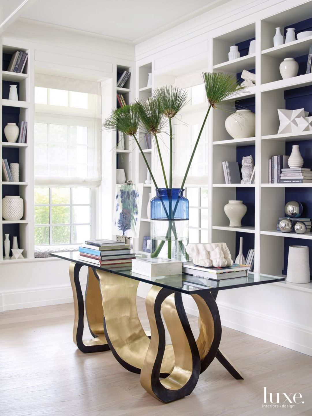 Modern White Library with Artistic Brass Table
