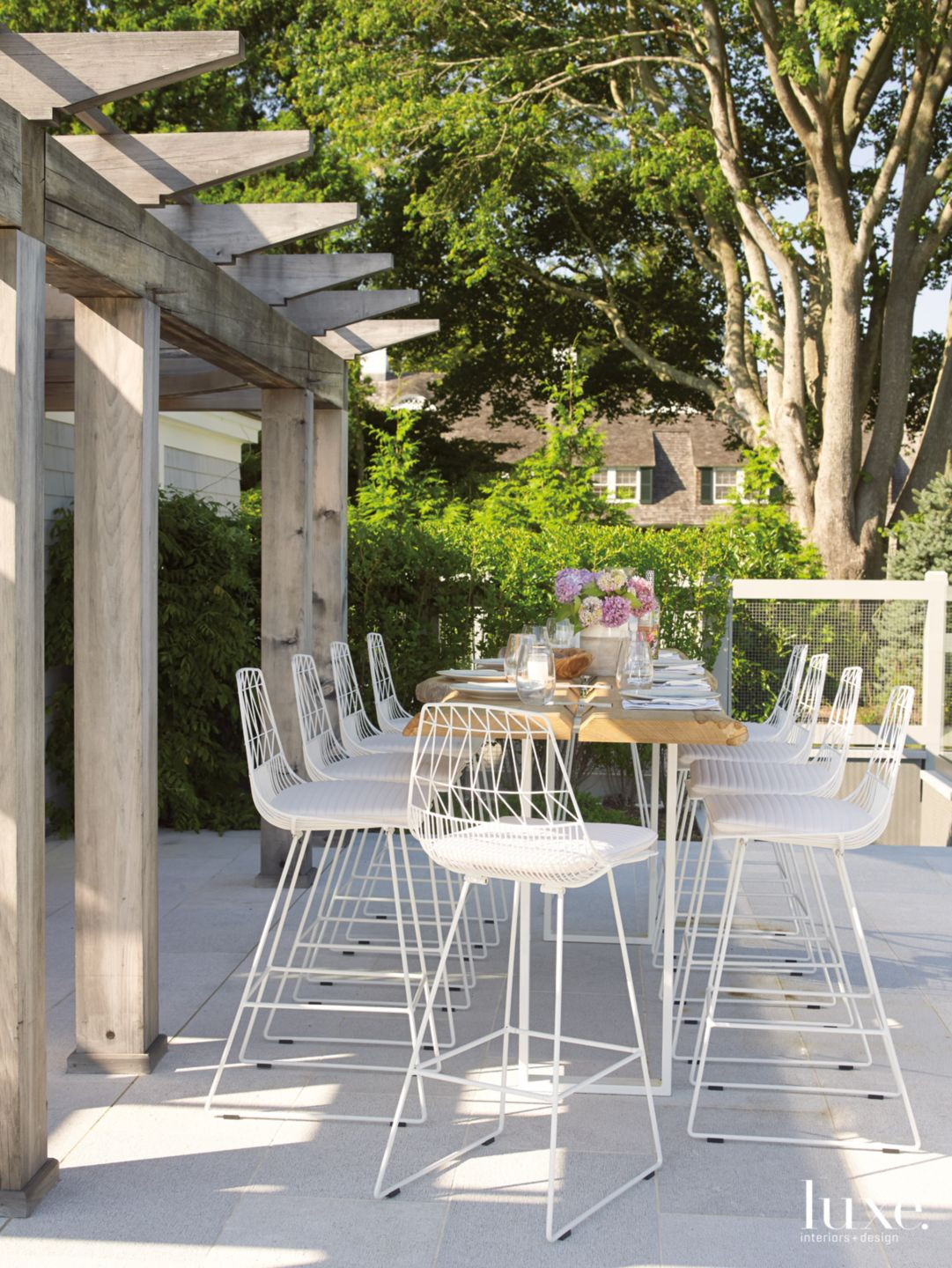 Modern Neutral Outdoor Dining Area with Teak Table