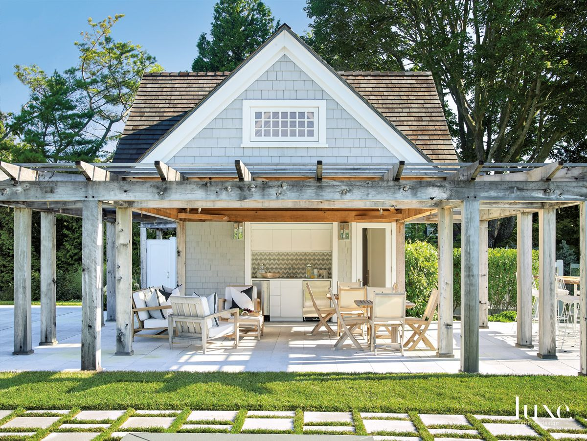 Traditional Neutral Pool House with Outdoor Kitchen