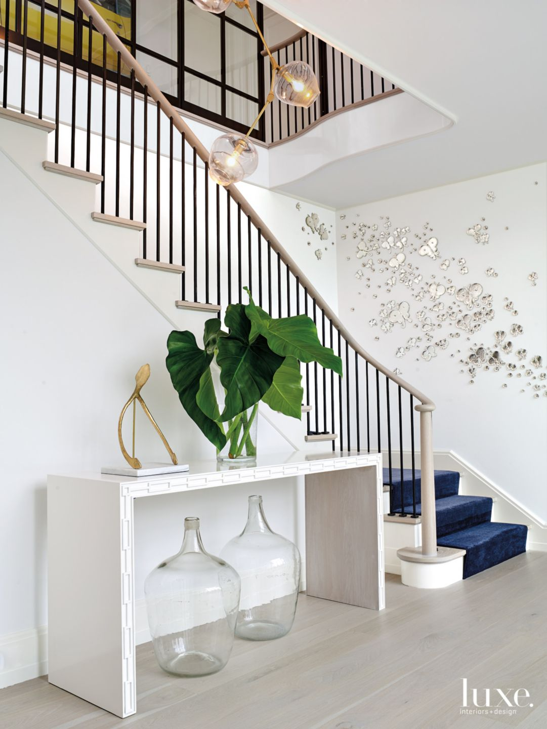 Modern White Staircase with Mirrored Butterfly Wall Décor