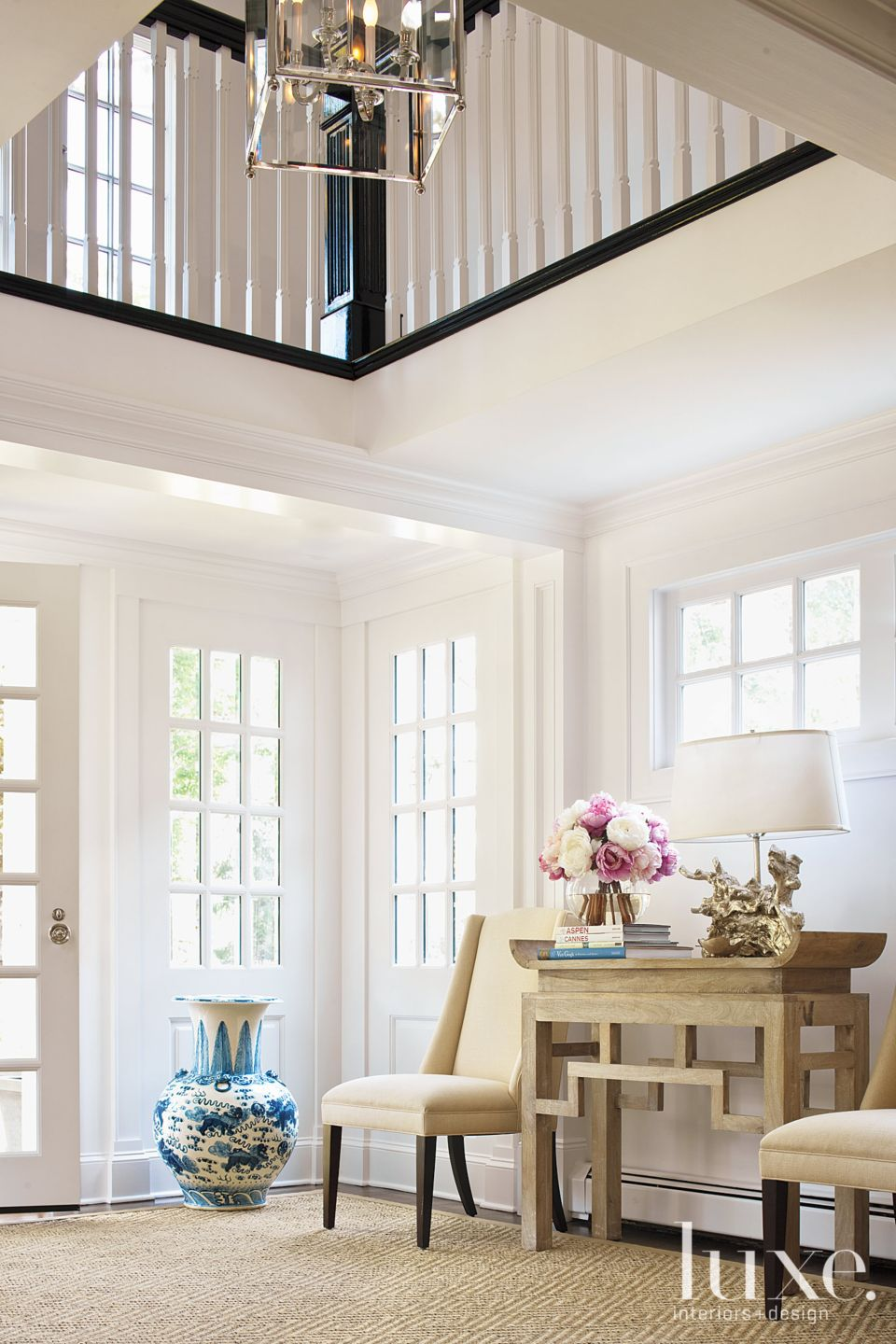 Traditional White Foyer with Floor Vase