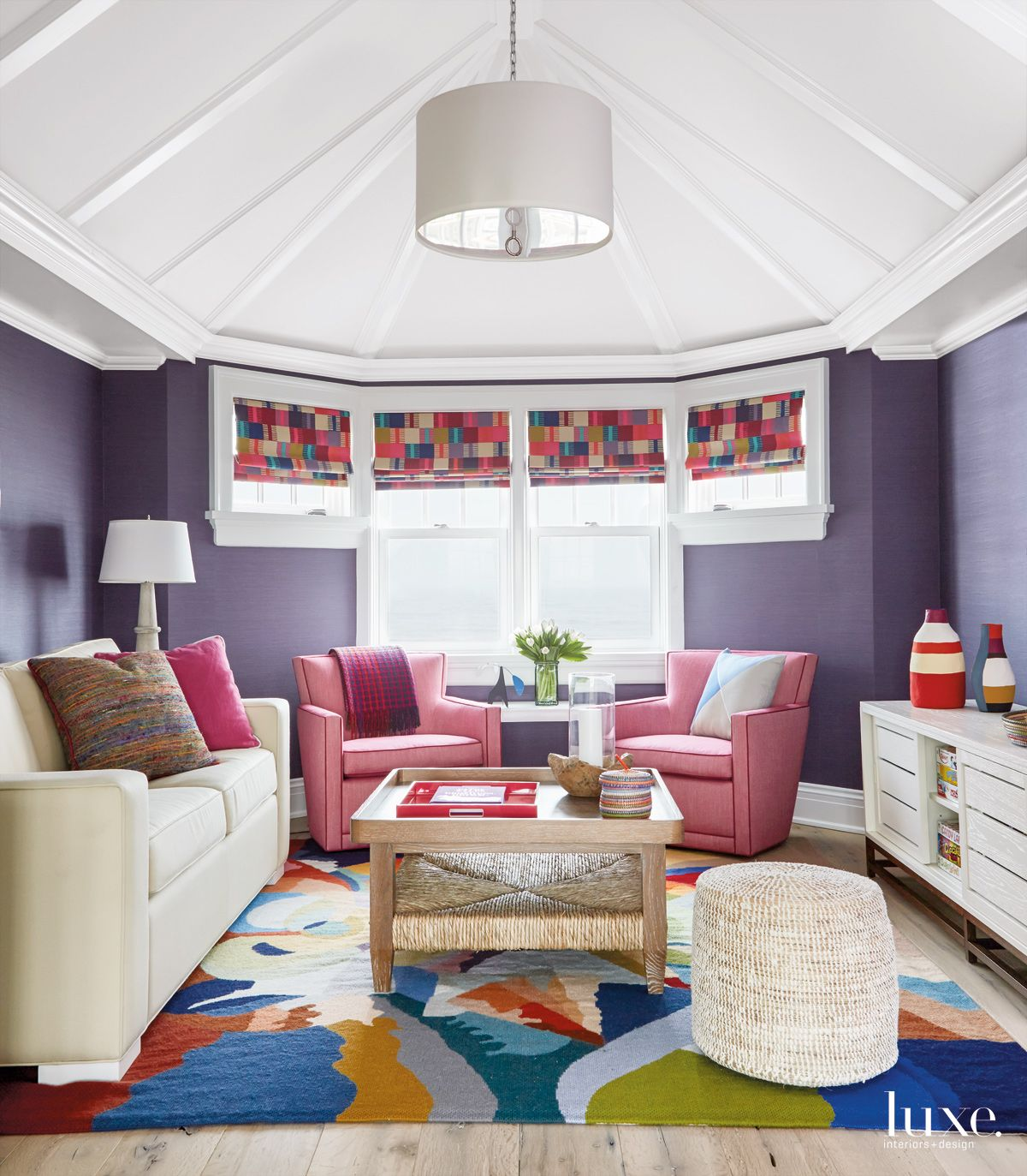 Contemporary Purple Sitting Room with Pink Armchairs