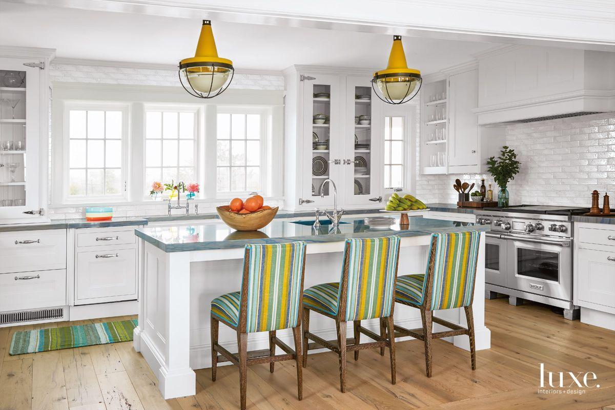 Contemporary White Kitchen with Marigold Pendants