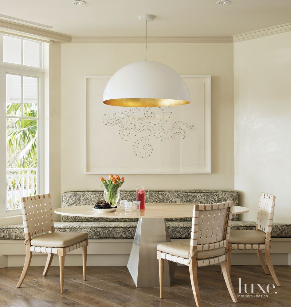Eclectic Cream Dining Area with Banquette Seating