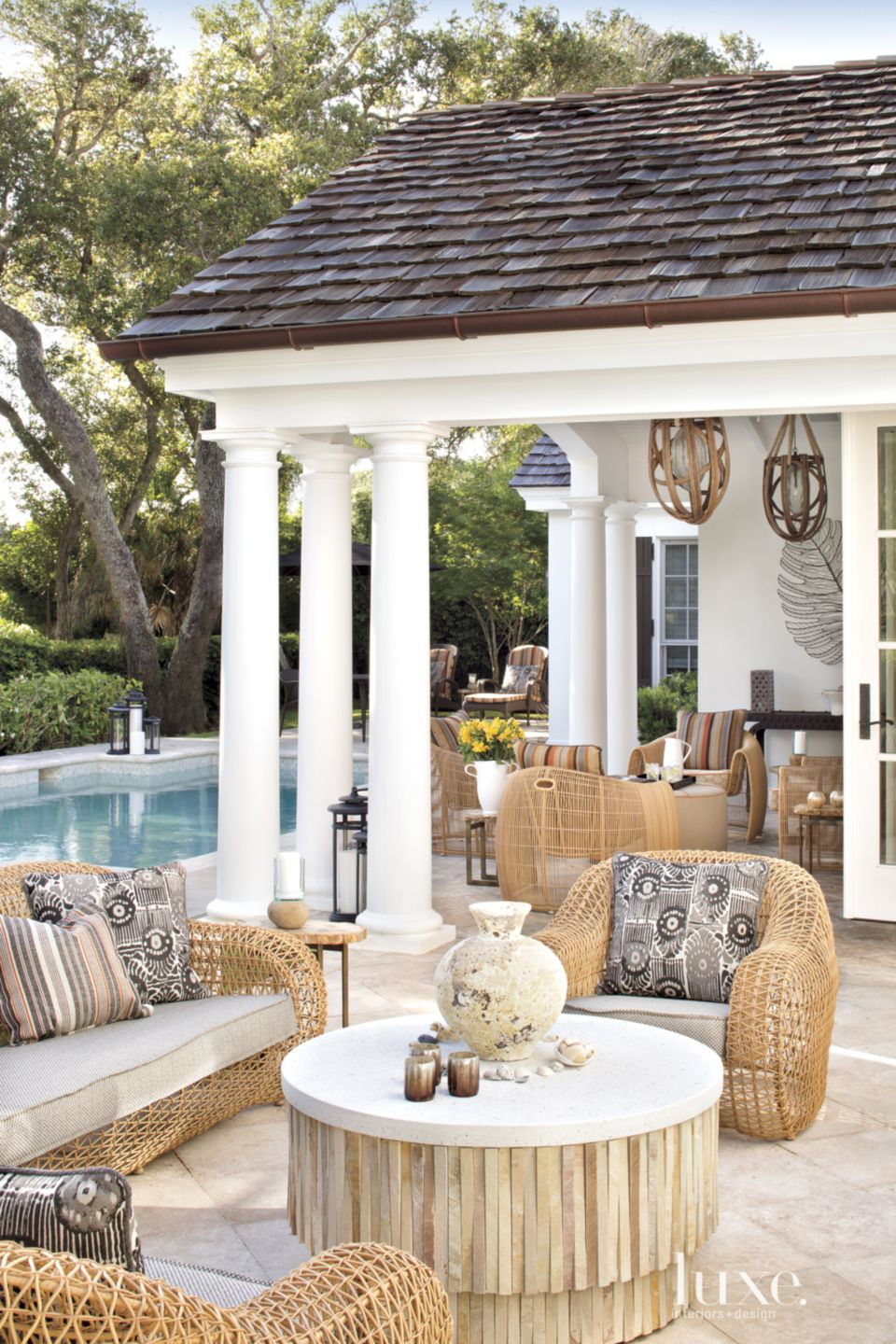 Contemporary Poolside Seating Area with Rattan Furnishings