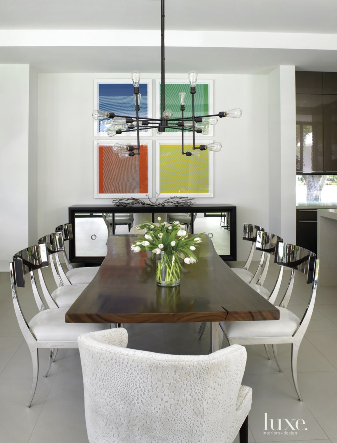 Modern White Dining Room with Industrial Light Fixture