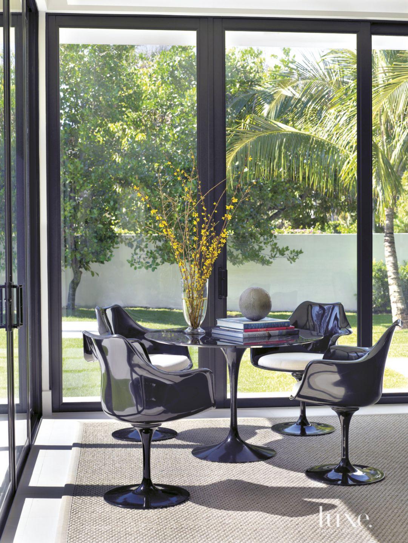 Modern Neutral Sitting Area with Saarinen Furniture