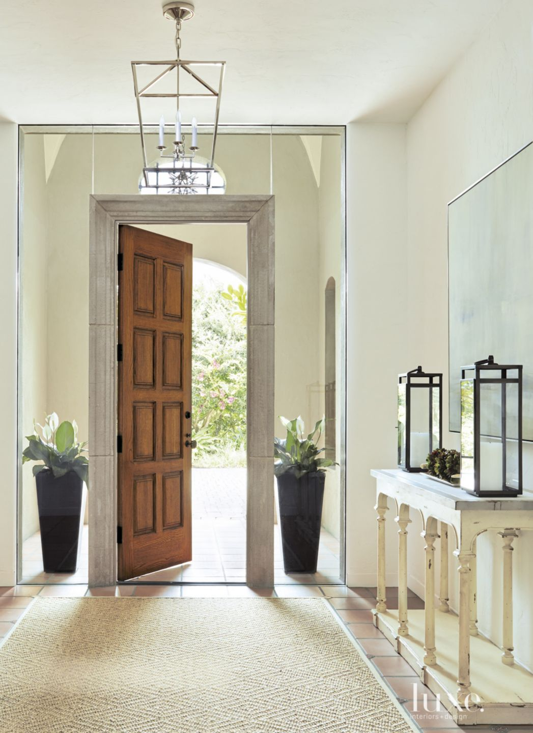 Traditional Cream Entry with Statement Light Fixture