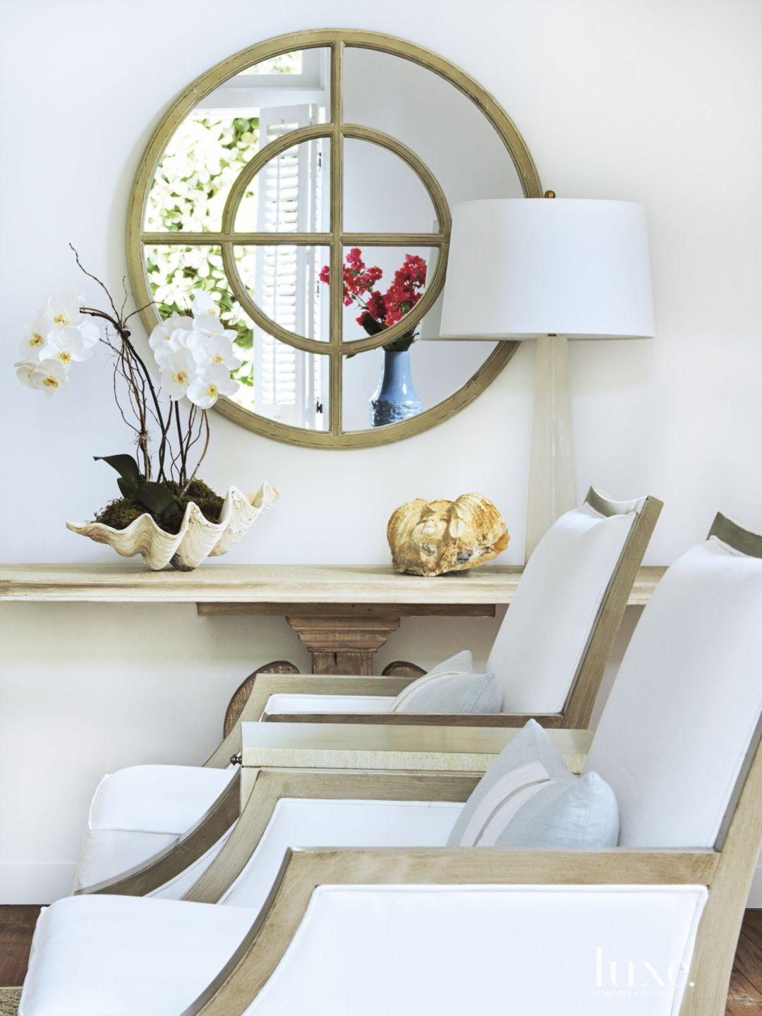 Contemporary White Living Area with Wood Mirror