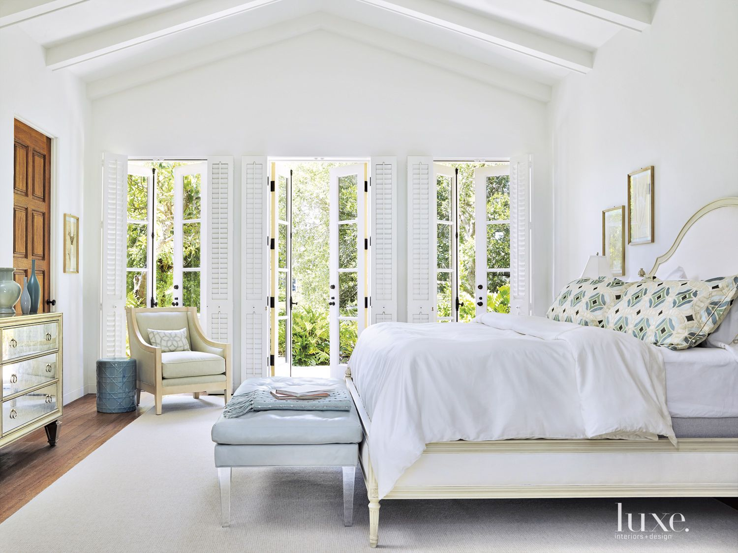 Traditional White Master Bedroom with Patterned Pillows