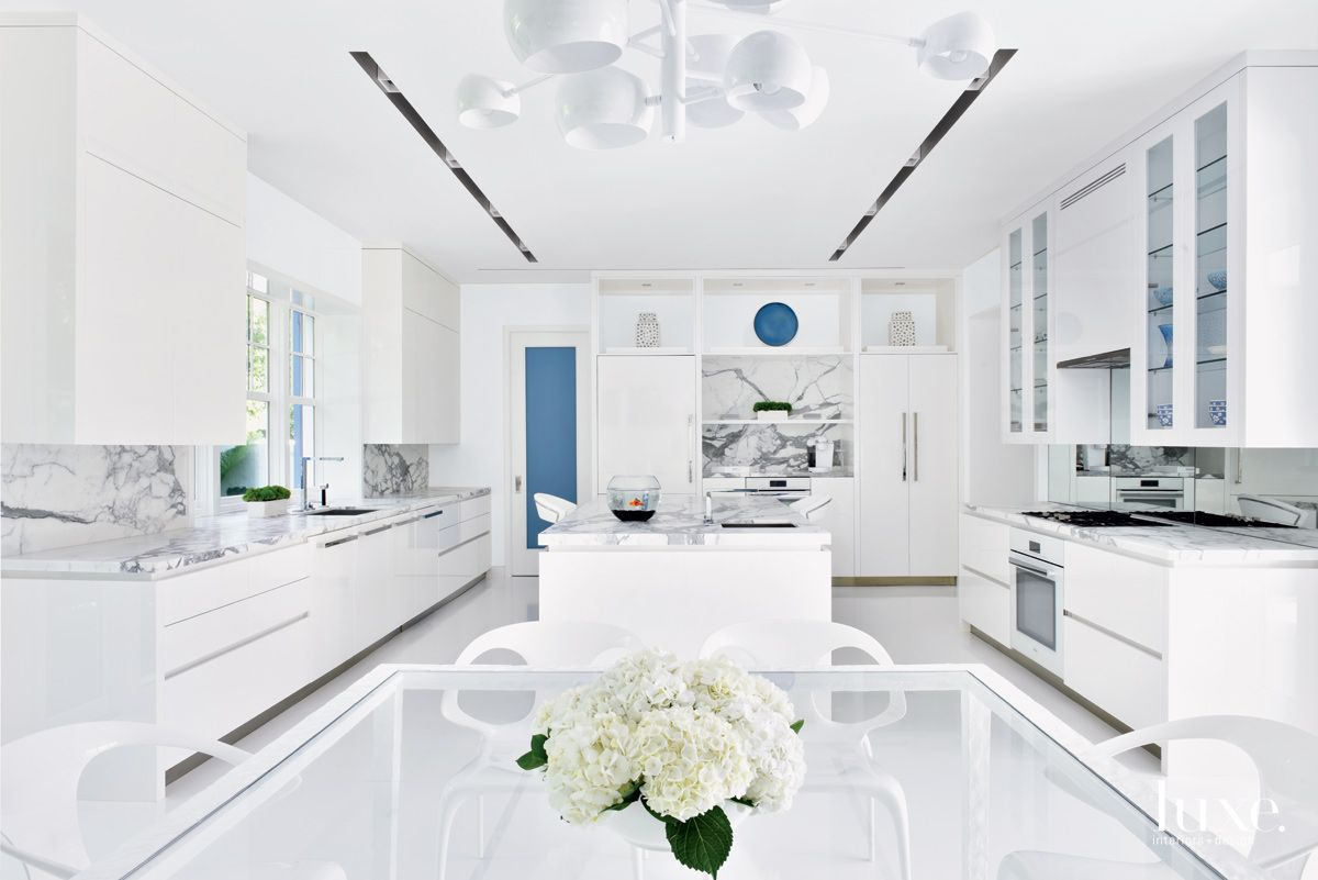 Contemporary White Kitchen with Marble Accents