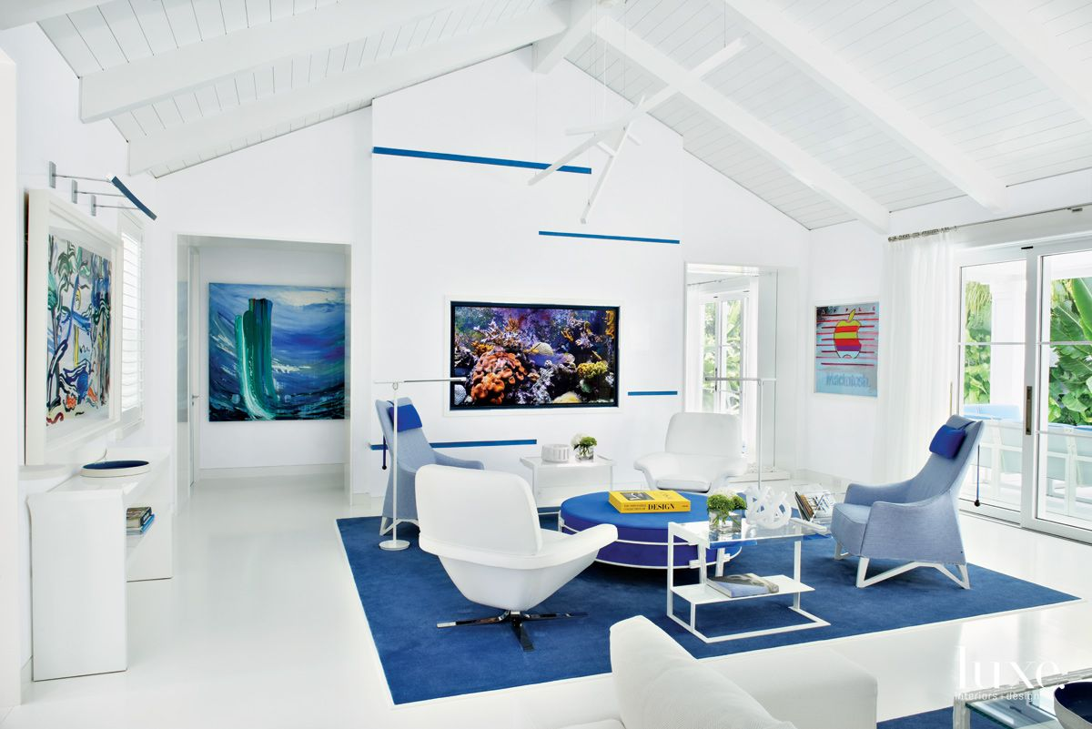 Contemporary White Living Room Seating Area with Swivel Chairs