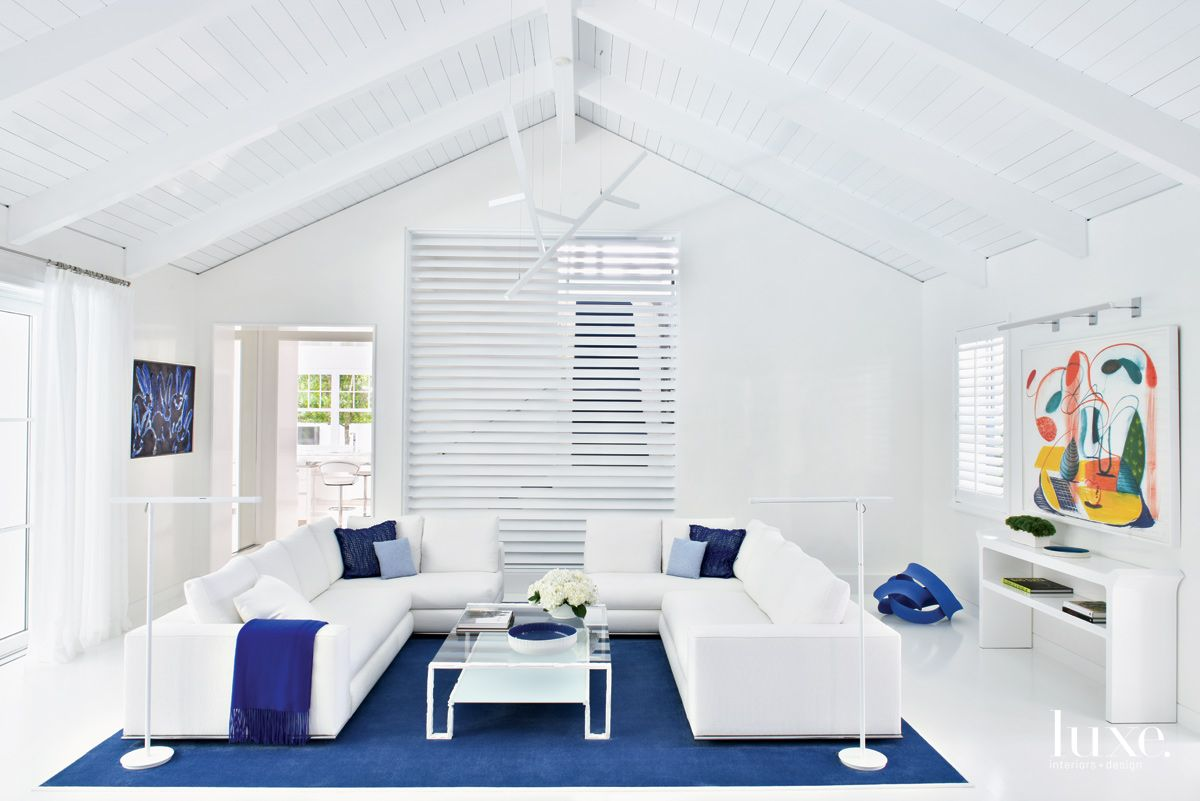 Contemporary White Living Room with Shutter-Style Wall