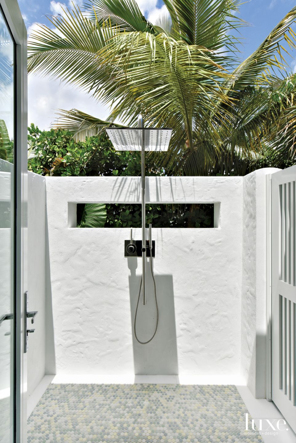 Contemporary White Outdoor Shower with Tile Floor