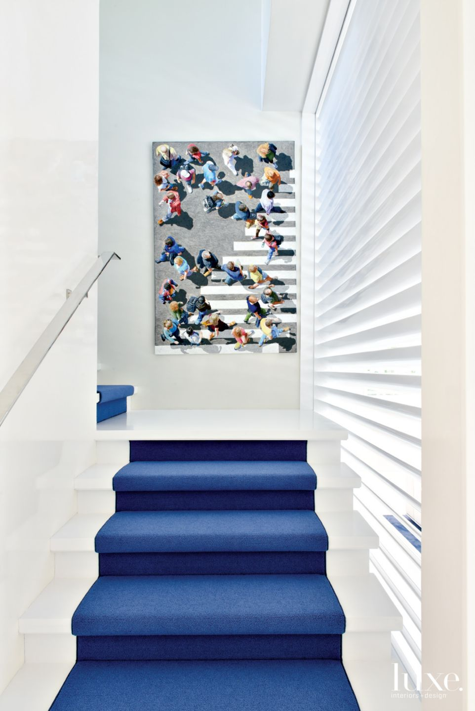 Contemporary White Stairway with Blue Runner