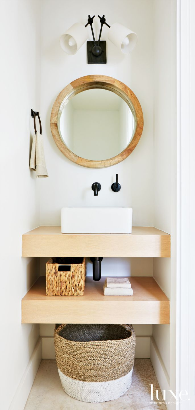 Modern White Powder Room with Porthole-like Mirror