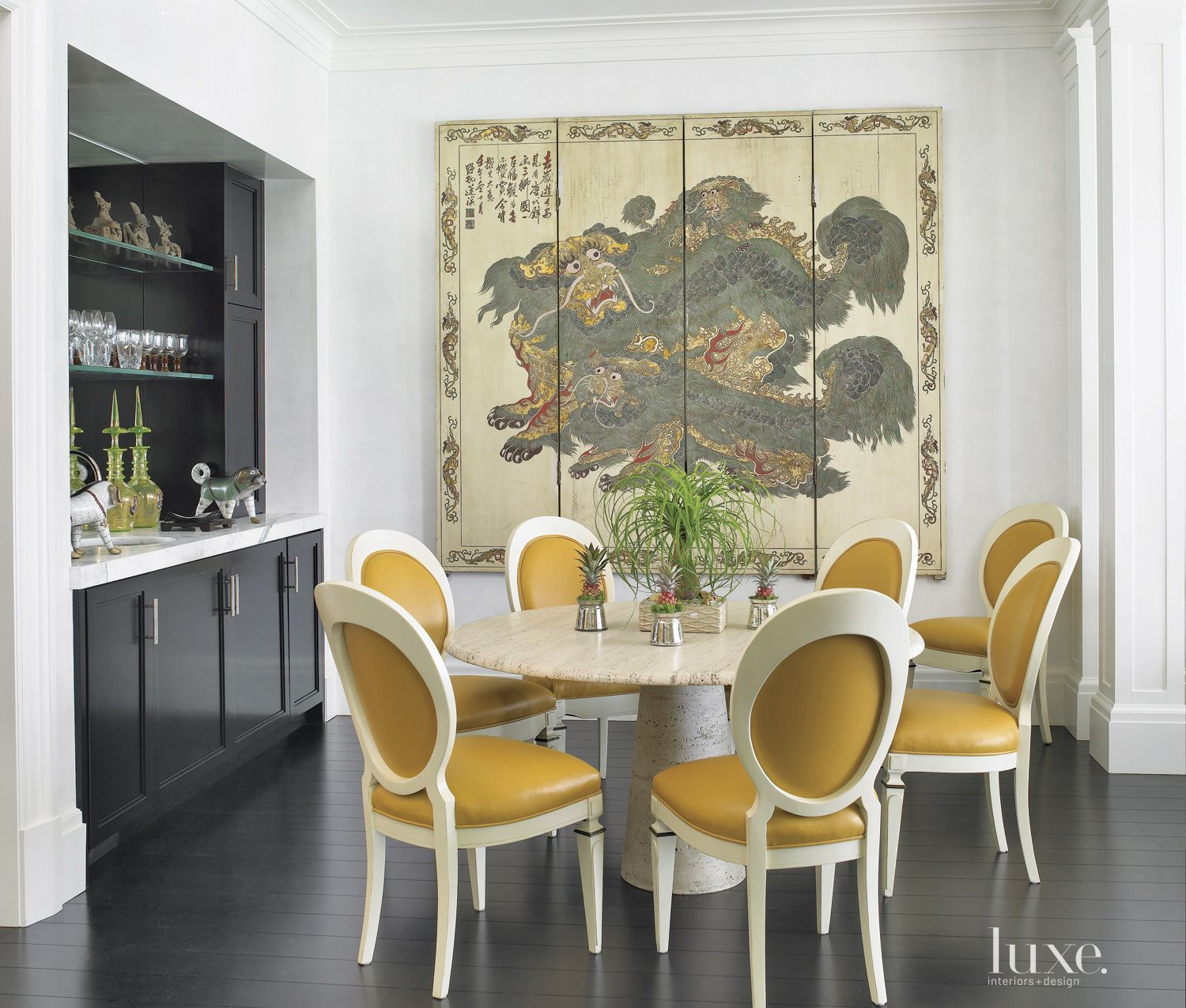 Eclectic White Dining Room with Butterscotch Accents