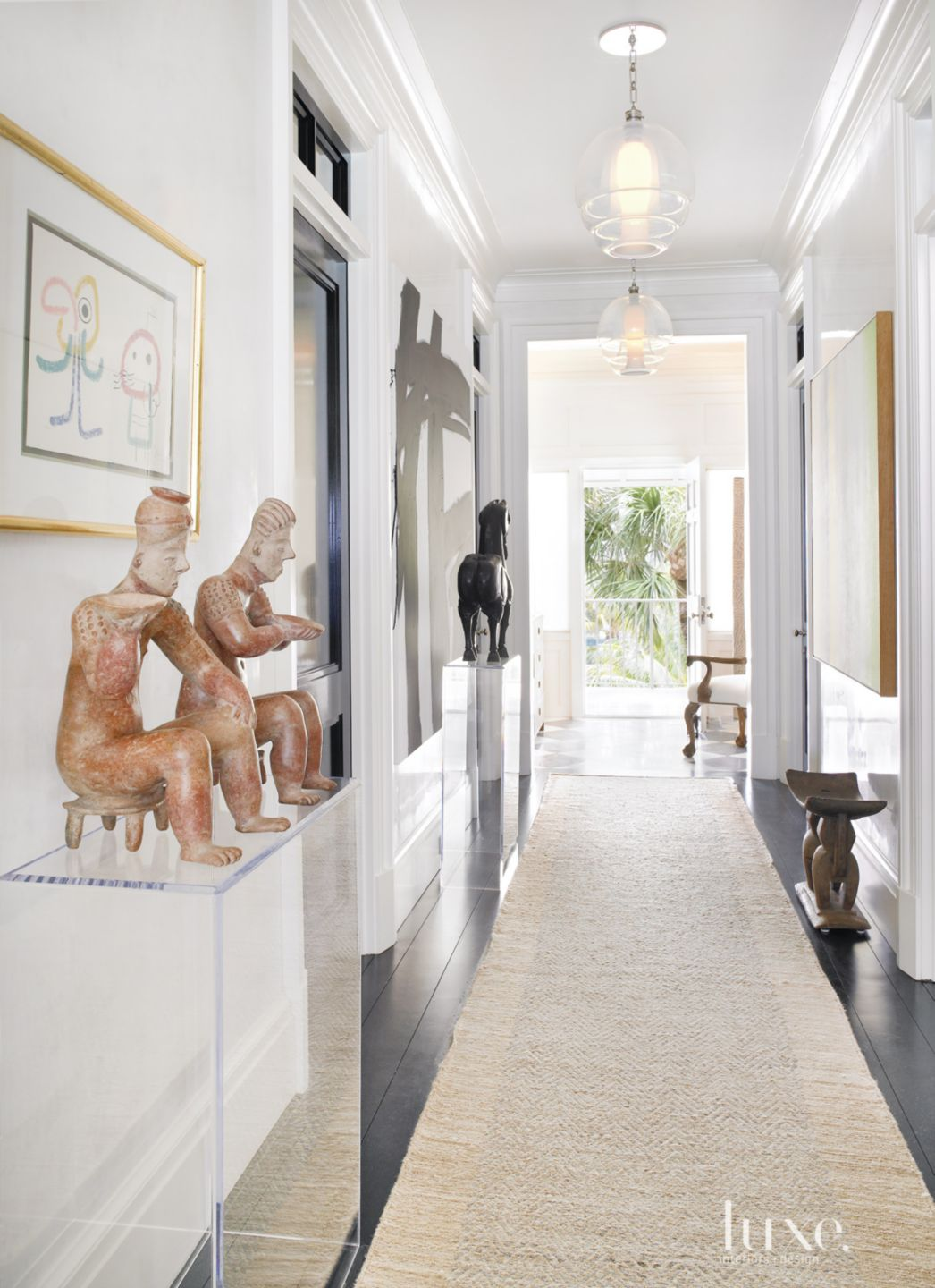 Eclectic White Entry Filled with Art