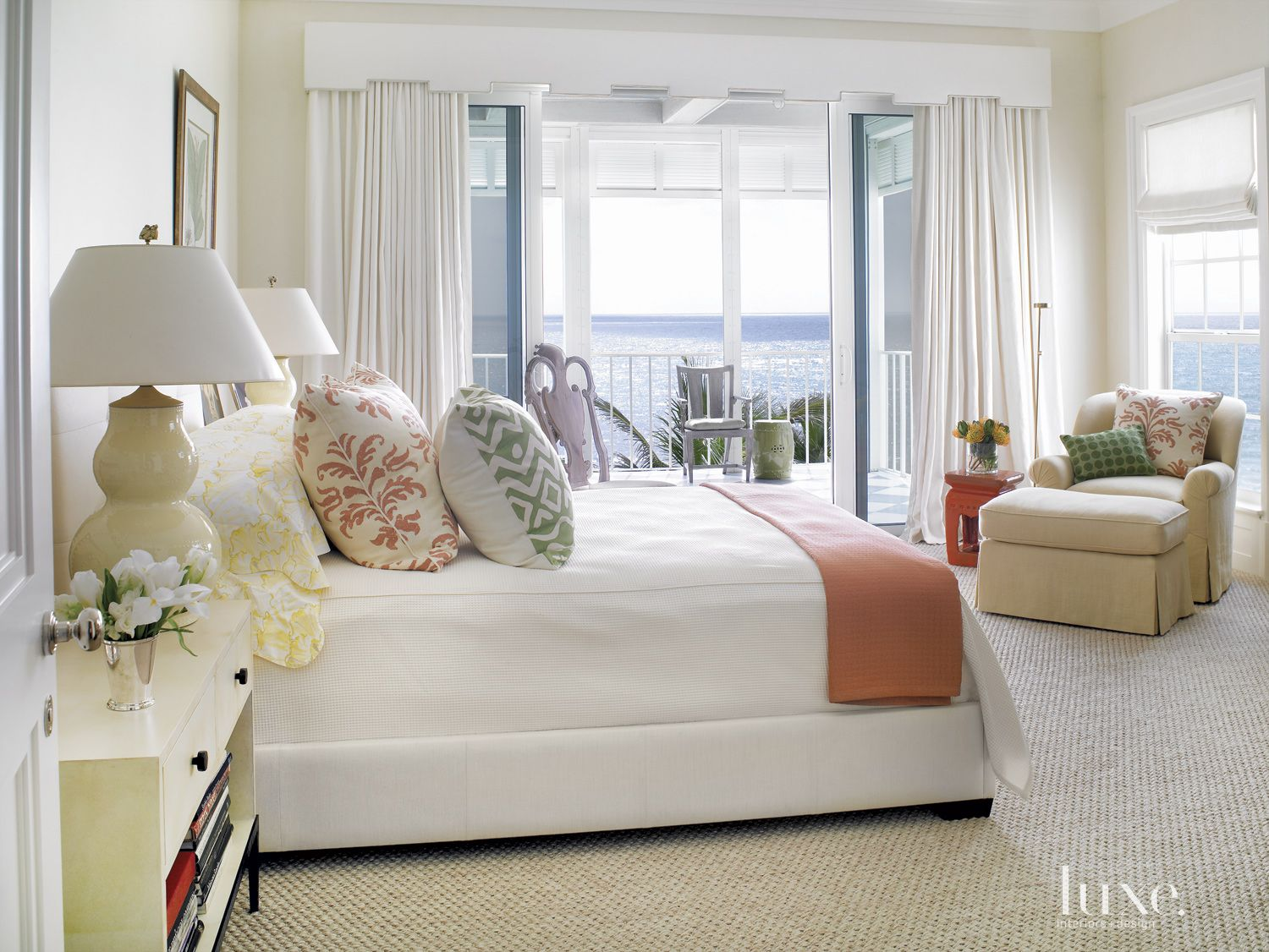 Eclectic White Master Bedroom with Orange Accents