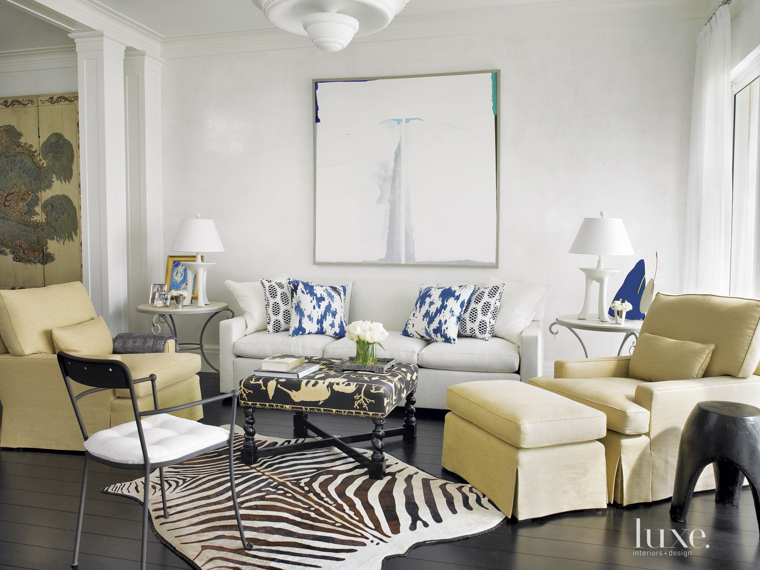 Eclectic White Family Room with a Zebra Rug