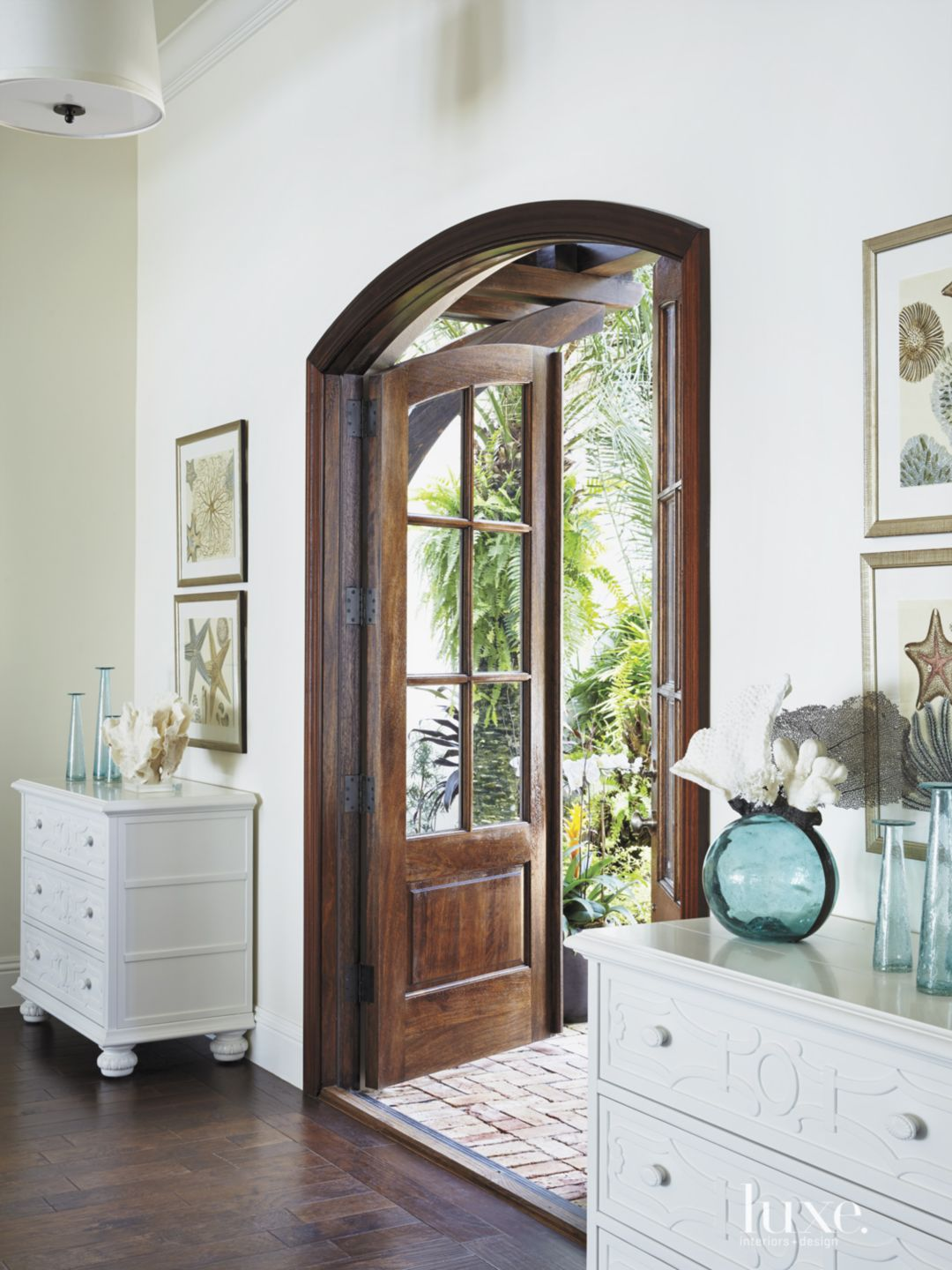 Eclectic White Foyer with Arched Entry