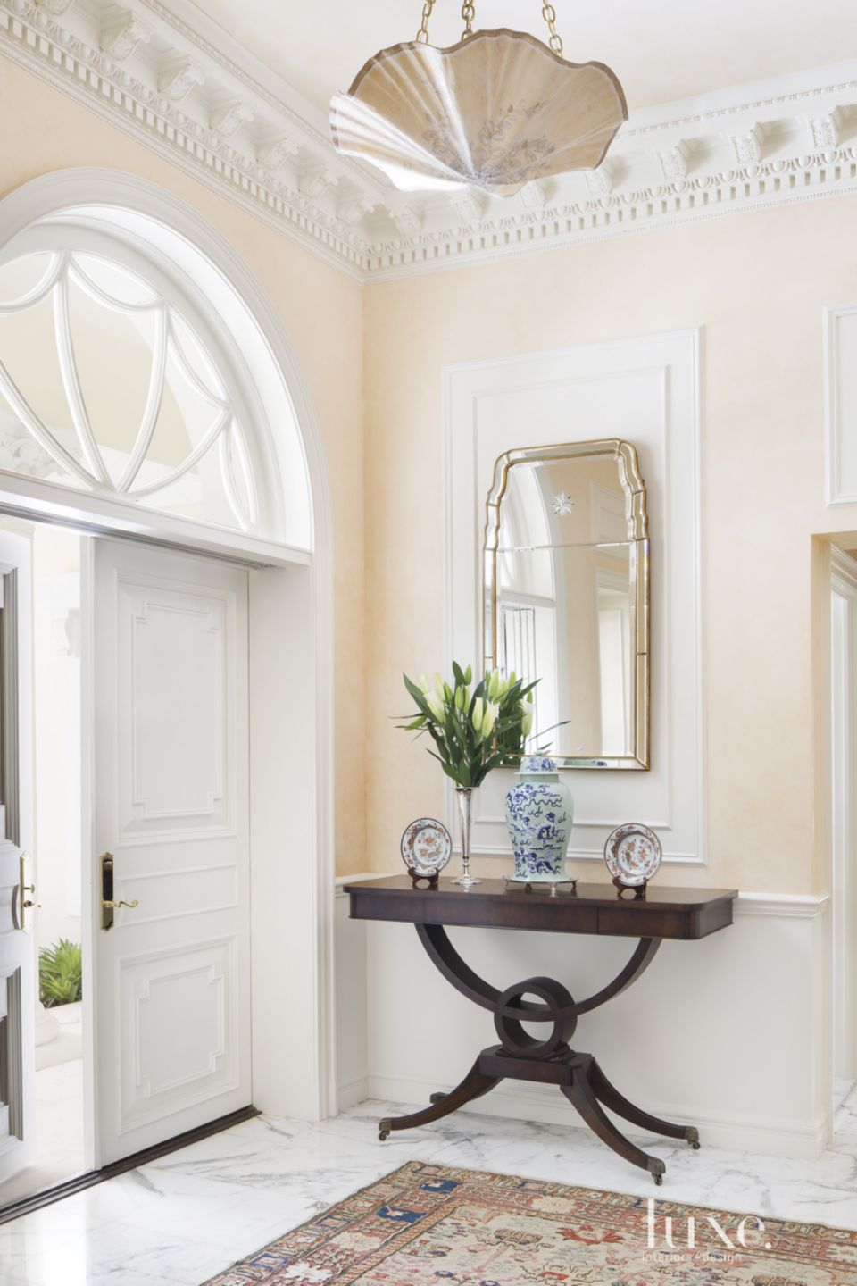Traditional Cream Foyer with Crown Molding