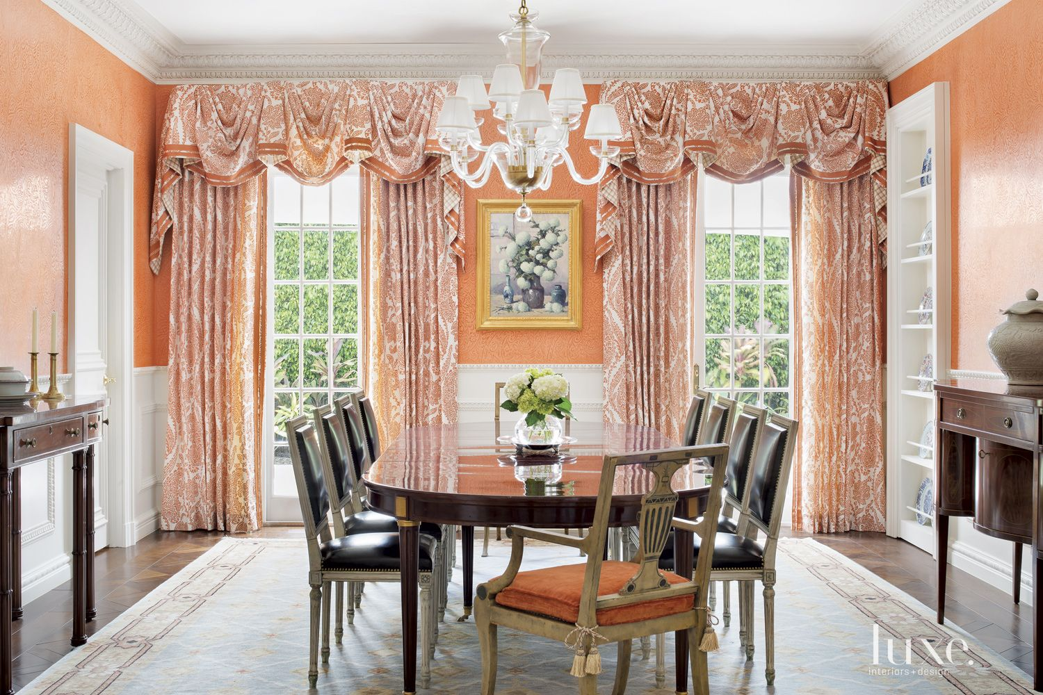 Traditional Orange Dining Room with Crown Molding