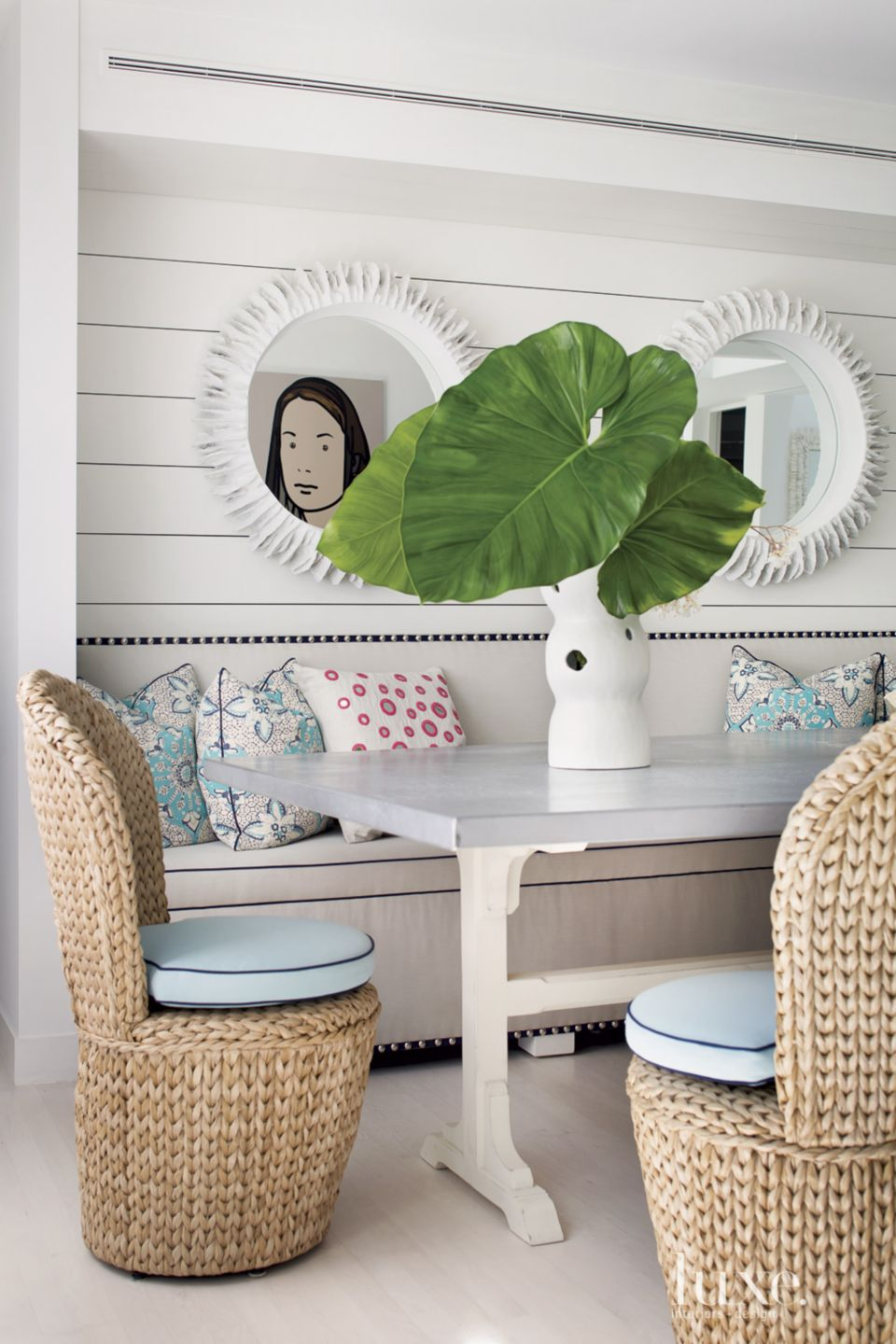 Eclectic White Dining Room with Banquette Seating