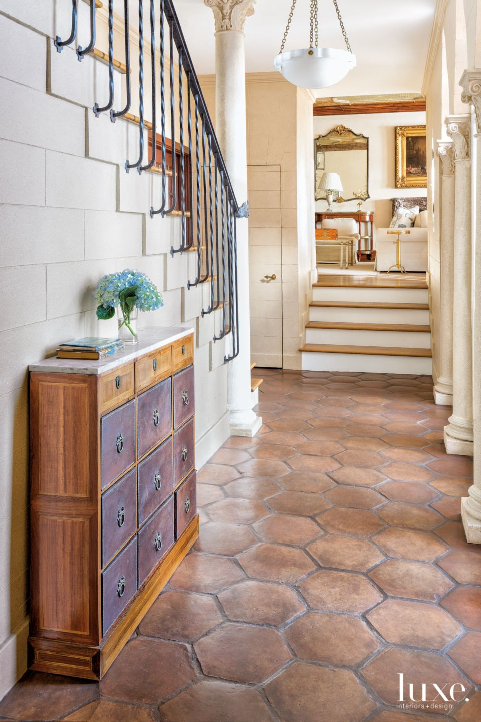 Traditional Cream Main Entry with Terra-Cotta Floor