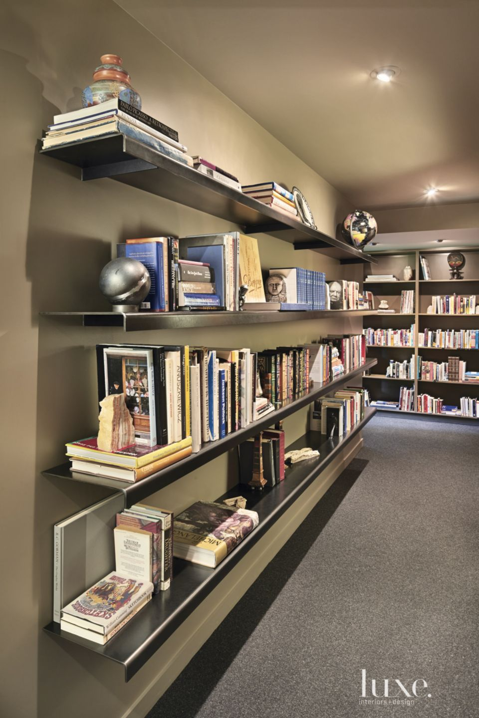 Contemporary Neutral Library with Blackened-Steel Shelving