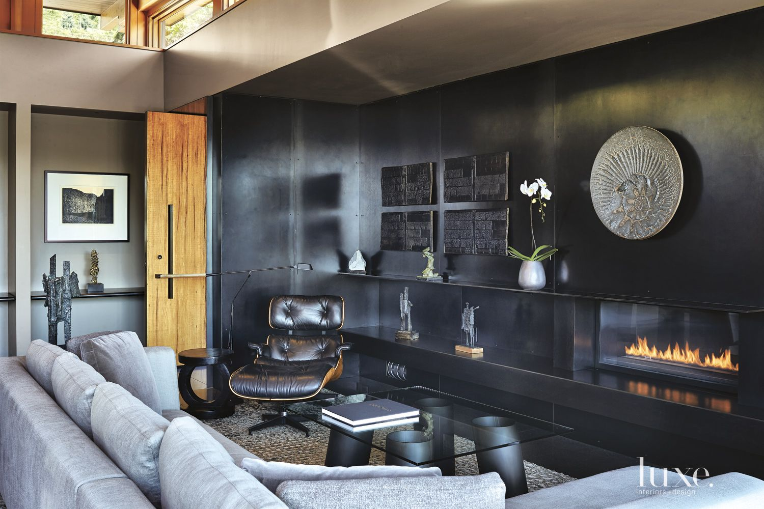 Contemporary Living Room with Blackened Steel Accent Wall
