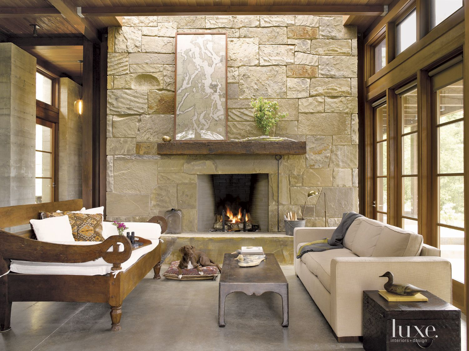 Neutral Mountain Living Room with Stone Fireplace