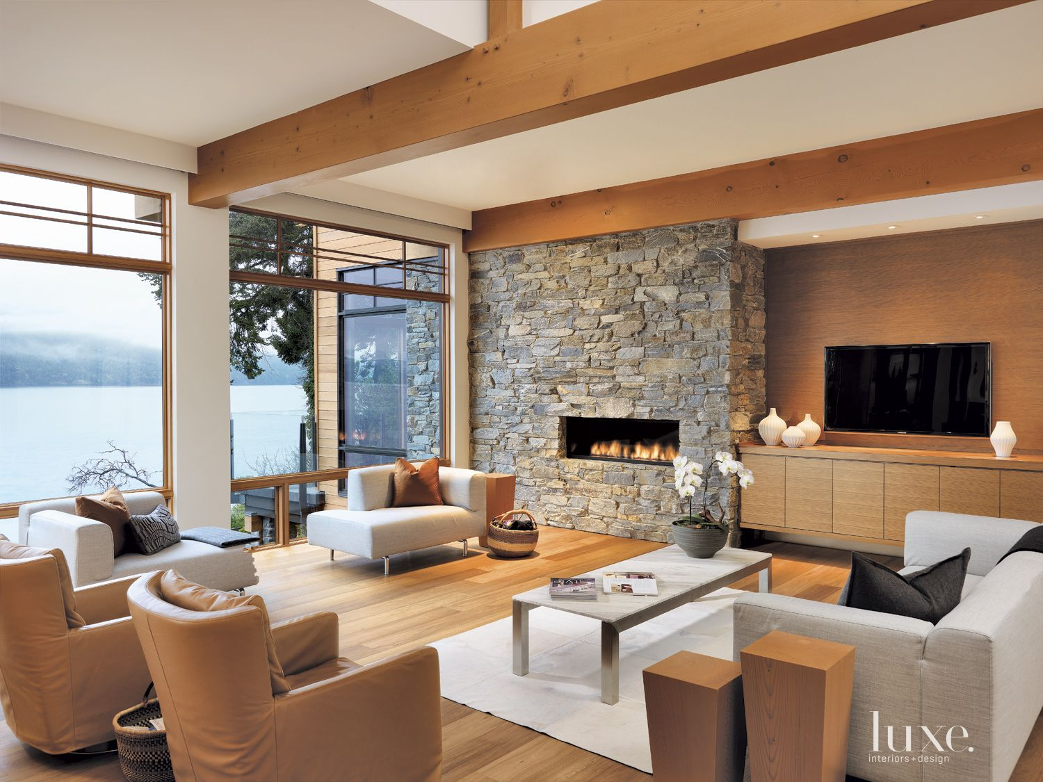 Contemporary White Living Room with Rustic Fireplace