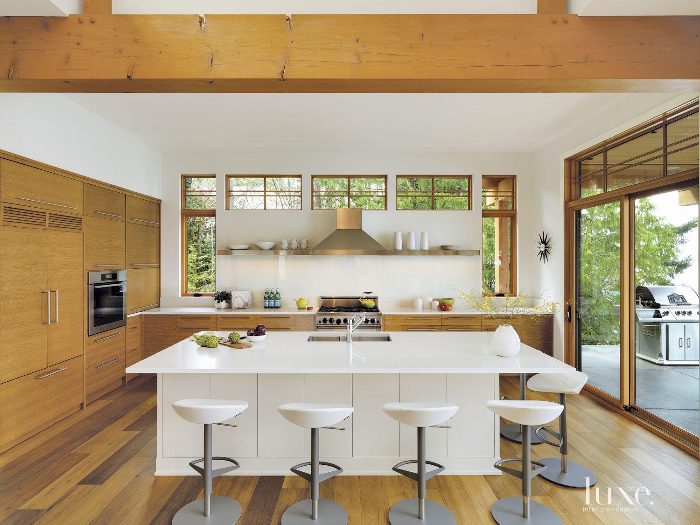 Contemporary White Kitchen with Glass Backsplash