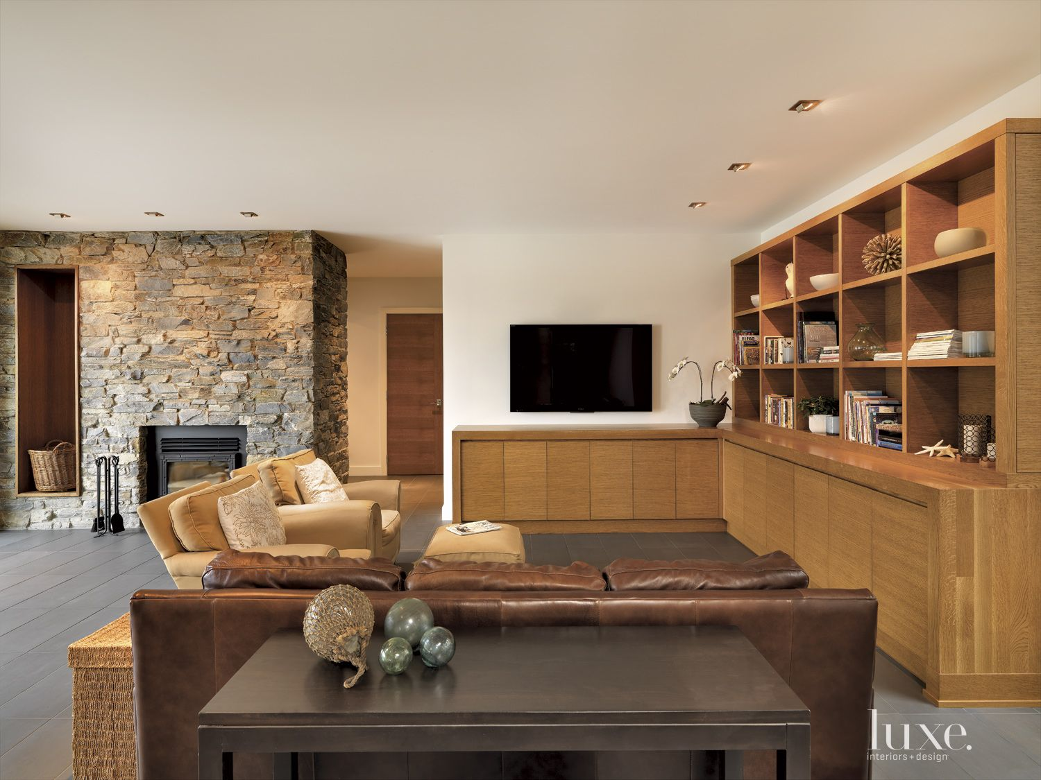 Contemporary White Living Room with Oak Cabinetry