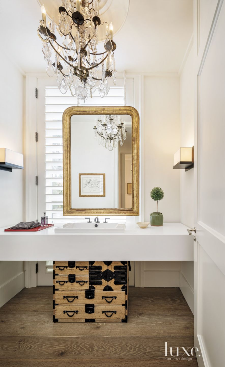 Contemporary White Powder Room with Antique Mirror