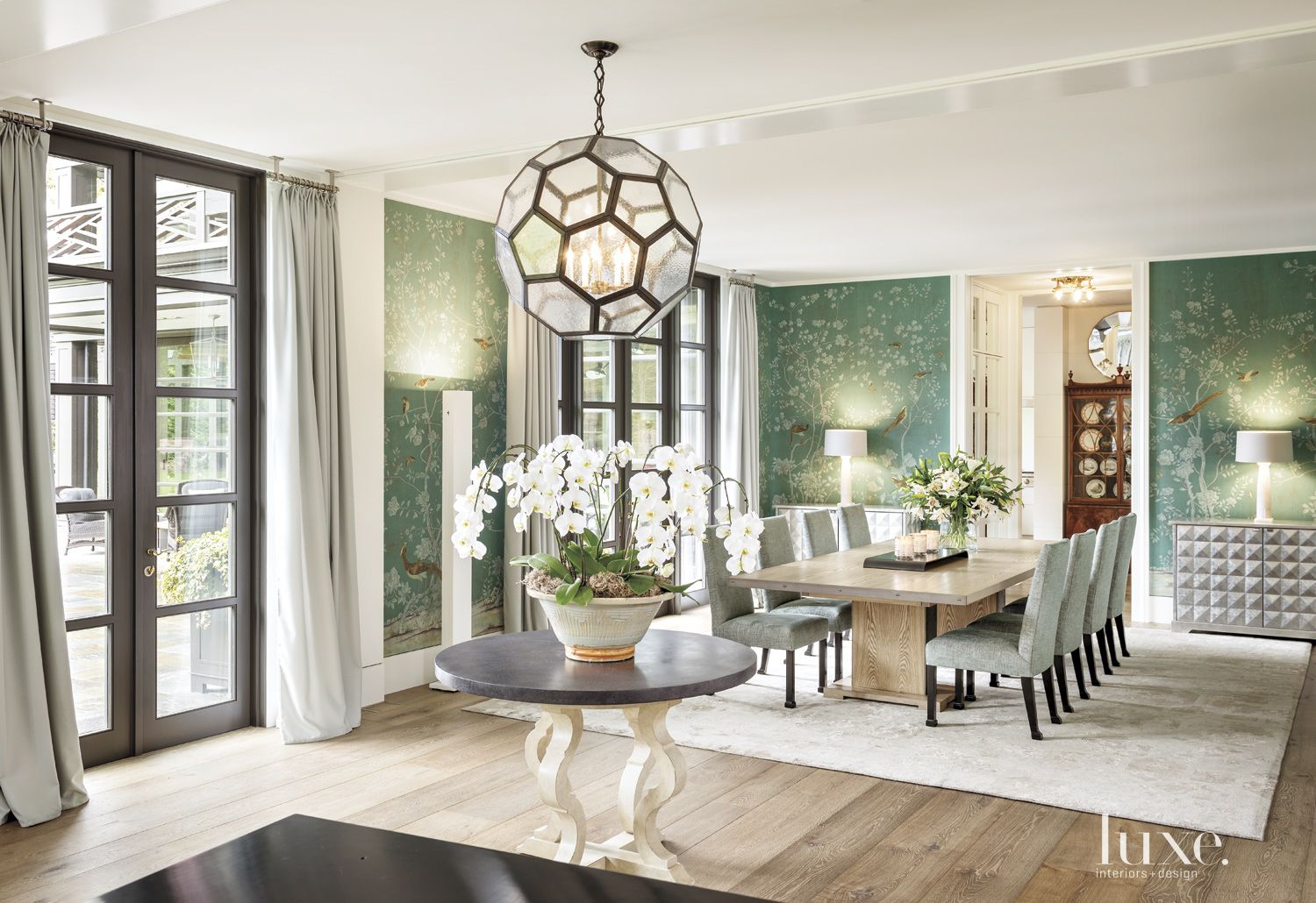 Contemporary White Dining Room with Handpainted Wallpaper