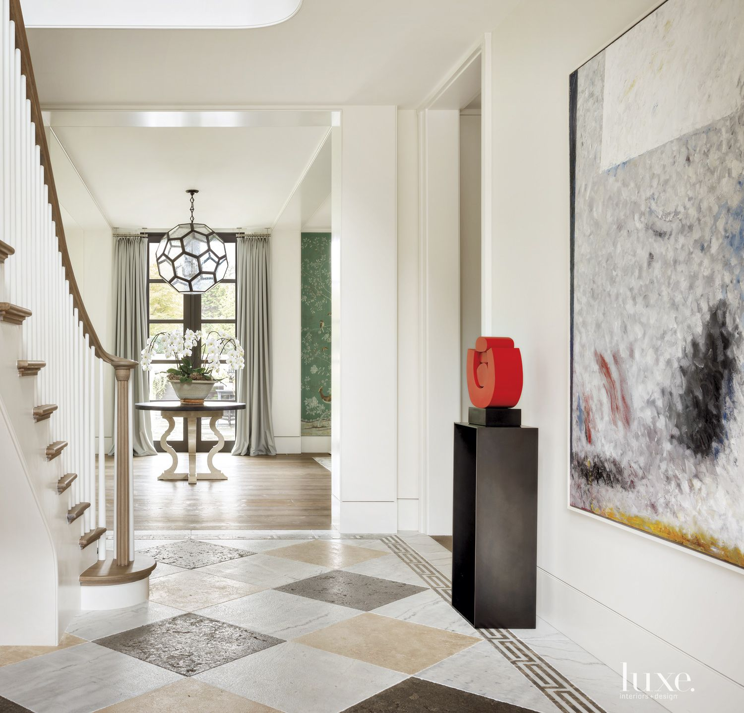 Contemporary White Foyer with Distressed Stone Tiles