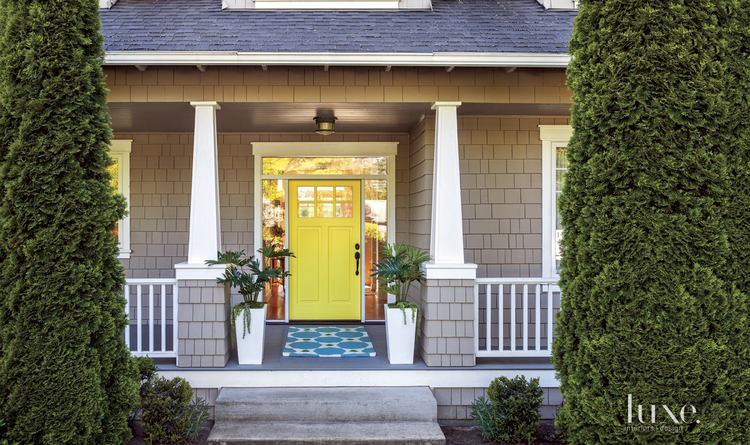 Traditional Neutral Exterior with Yellow Front Door