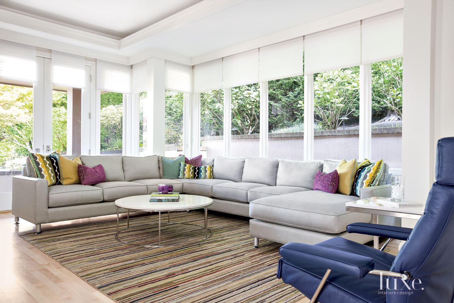 Modern Neutral Family Room with Many Windows