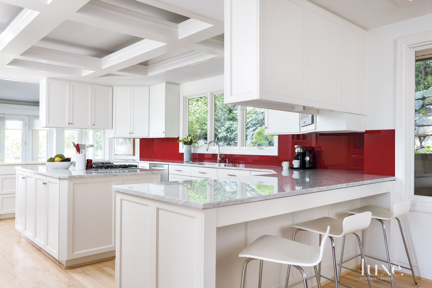 Modern White Kitchen with Red Backsplash