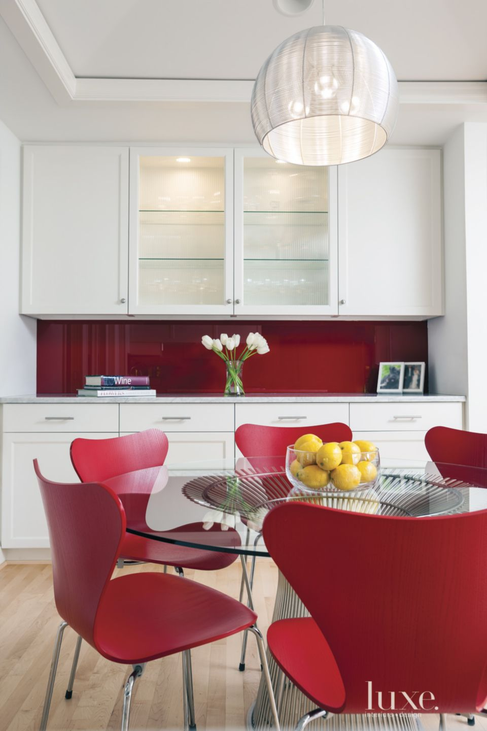 Modern White Kitchen with Red Chairs