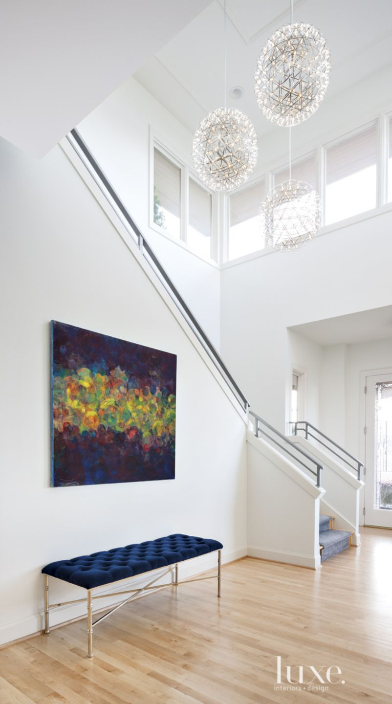 Modern White Foyer with Blue Bench
