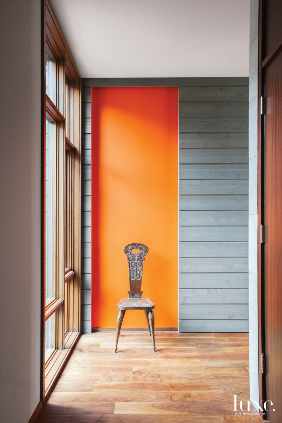 Contemporary Gray Hallway with Orange Accent